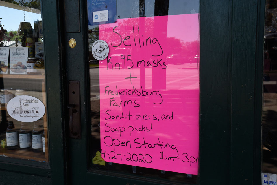 The Sweet Lily, located on Main Street, advertises its re-tail-to-go opening on their front door. Gov. Abbott issued an order allowing to-go retail ear-lier this week, and several businesses in Fredericksburg will offer curbside retail start-ing tomorrow. — Standard-Radio Post/Samuel Sutton