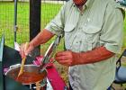 """Bobby Delery stirs his pot of """"Borderline Chili"""" Satur-day at the Eighth Annual Harper Barbecue and Chili Cookoff. Delery entered the competition after a 10-year hiatus from competing in cooking contests."""