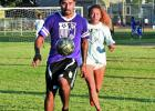 "Enrique Ramirez, soccer player for ""The Texicans,""handles the ball away from Magdiel Ramirez, a player for ""The Justice League"" during a soccer match on Wednesday, July 13. — Standard-Radio Post/Scott Allen"